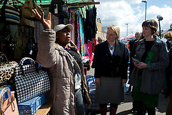 © Licensed to London News Pictures. 30/04/2015. <br /> LONDON, UK. Green Party leader Natalie Bennett (C) visits Ridley Road Market in Hackney, London. On her visit she talks to locals and stall holders, Thursday 30 April 2015. Photo credit : Hannah McKay/LNP