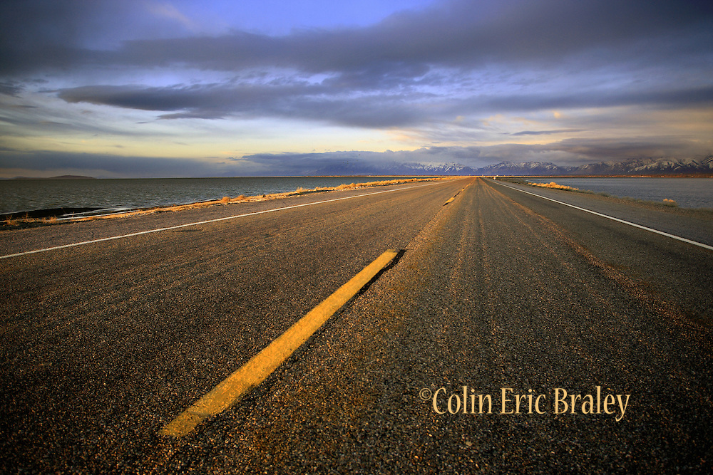 The fading light of the setting sun casts a warm glow on the Antelope Island causway, April 9, 2008. The roadway links Antelope Island State Park with Utah's mainland. Colin Braley/Stock