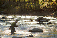 Cornwall, New York - A man fishes with a fly rod in the Moodna Creek on Oct. 14, 2012.