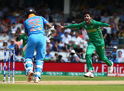 June 18, 2017 - London, United Kingdom - Muhammad Amir of Pakistan celebrate the wicket of Shikhar Dhawan of India.during the ICC Champions Trophy Final match between India and Pakistan at The Oval in London on June 18, 2017  (Credit Image: © Kieran Galvin/NurPhoto via ZUMA Press)