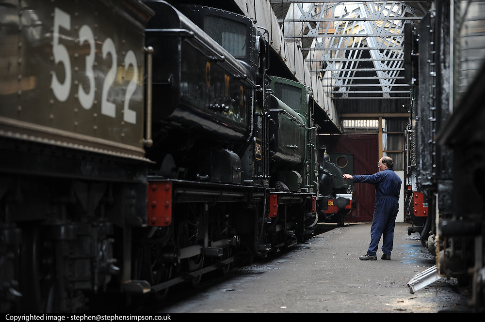 ©London News pictures. 30/03/2011. The King Edward II steam locomotive is moved from her protective shed at the Railway Centre in Oxfordshire, England, on 30th March 2011, ahead of her public unveiling this weekend. A small group of volunteer workers met every two weeks and completed the restoration of the engine, once destined for the scrap heap, after 20 years. King Edward II is a Great Western Railway (GWR) heavy express steam locomotive, one of only three surviving members of this class of locomotive. King Edward II performed over 1,500,000 miles of service pulling trains between London Paddington and the West of England, and also in latter years between Paddington and South Wales or Wolverhampton. Introduced in the 1920s for taking express trains over the steep gradients (banks) of South Devon, the Kings were withdrawn in the early 1960s as diesel locomotives replaced them. 6023 spent many years rotting at Barry Scrapyard, and had her rear driving wheels cut through with an oxy-acetylene torch after a shunting accident. . Picture credit should read Stephen Simpson/LNP