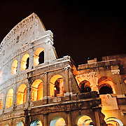 ROME, Italy - A telephoto shot of part of the famous Coliseum of Rome under lights at night.