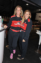 Left to right, AMBER NUTTALL and SAM SOPWITH at a Girl Karting - a charity Go-Karting evening in aid of Too Many Women held at The Raceway, 3 Herringham Road, London SE7 on 12th September 2012.