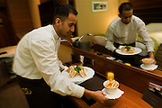 A hotel waiter delivers a meal ordered from toom service in the heathrow Airport Sofitel, attached to Terminal 5.