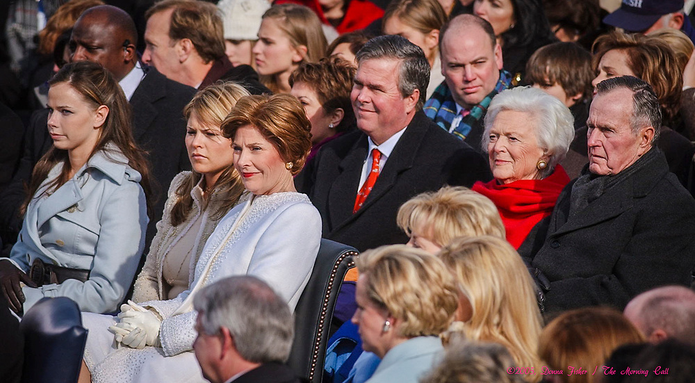 WASHINGTON, D.C. - Family members daughters Jenna and Barbara Bush, wife Laura Bush, brother Jeb Bush and parents Barbara and George H.W. Bush watch George W. Bush swearing-in ceremony at the U.S. Capitol.  Inauguration ceremonies for the second term of President George W. Bush at the U.S. Capitol, along the National Mall and along Pennsylvania Avenue on January 19, 2005 and January 20, 2005. Photography ©DONNA FISHER/The Morning Call