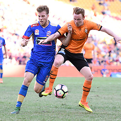 BRISBANE, AUSTRALIA - JANUARY 7: Corey Brown of the Roar and Andrew Hoole of the Jets compete for the ball during the round 14 Hyundai A-League match between the Brisbane Roar and Newcastle Jets at Suncorp Stadium on January 7, 2017 in Brisbane, Australia. (Photo by Patrick Kearney/Brisbane Roar)