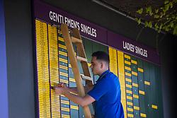 July 2, 2018 - London, United Kingdom - 180702 A staff-member updates the scoreboards during day 1 of Wimbledon on July 2, 2018 in London..Photo: Ludvig Thunman / BILDBYRN / kod LT / 35496 (Credit Image: © Ludvig Thunman/Bildbyran via ZUMA Press)