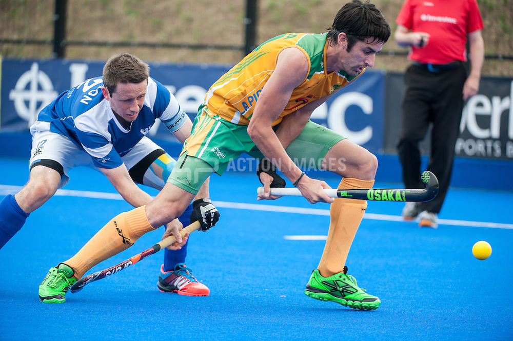 Miguel Da Grace (RSA) is tackled by Chris Nelson (SCO). Scotland v South Africa, 3rd/4th play-off, Investec London Cup, Lee Valley Hockey & Tennis Centre, London, UK on 13 July 2014. Photo: Simon Parker