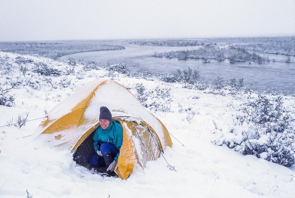 Debbie Wukasch, Noatak River wilderness campsite, late August snowstorm, Gates of the Arctic National Park, Alaska, USA