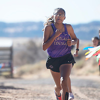 Kirtland Central's Aisha Ramone runs 19:50.8 finishing in first place at the NMAA District 1-4A Championship meet at Red Rock Park Saturday. Miyamura's Lorianna Piestewa finished second with a time of 19:50.9.