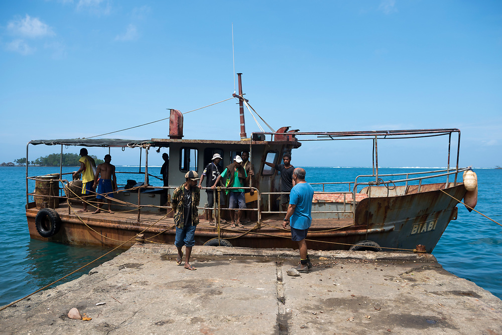 The M.V. Biabi, a boat that transports copra (dried coconut), passengers, and other cargo, readies for its departure from Karkar Island to the mainland port of Madang, Papua New Guinea. (August 2017)