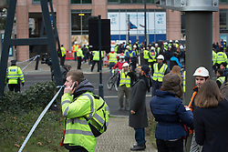 © licensed to London News Pictures. London, UK 16/01/2013. People waiting outside the cordoned off area after a reported helicopter crash in Vauxhall, London. Photo credit: Tolga Akmen/LNP