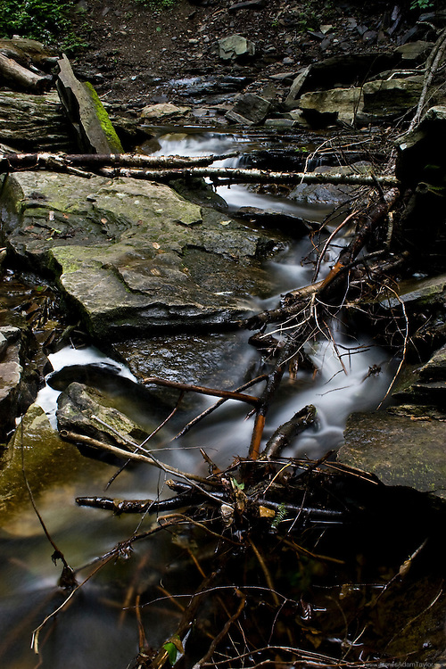 water spills over rocks along kitchen creek in Ricketts Glen state park, Luzerne, Sullivan and Columbia counties, PA.