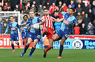 Wycombe Wanderers Alex Samuel (25) and Wycombe Wanderers Nathan Tyson(23) challenge Sunderland defender Tom Flanagan (12) *** during the EFL Sky Bet League 1 match between Wycombe Wanderers and Sunderland at Adams Park, High Wycombe, England on 9 March 2019.