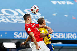 July 3, 2018 - Saint Petersburg, Russia - Viktor Claesson (R) of Sweden national team and Granit Xhaka of Switzerland national team vie for a header during the 2018 FIFA World Cup Russia Round of 16 match between Sweden and Switzerland on July 3, 2018 at Saint Petersburg Stadium in Saint Petersburg, Russia. (Credit Image: © Mike Kireev/NurPhoto via ZUMA Press)