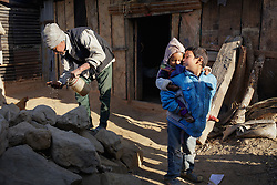 Sushil, 7, kisses his youngest sister, 11-month-old Kusum, in front of their temporary home.<br /> <br /> Niruta and Durga were married 9 years ago, when they were just 14 and 16 years old in the Kagati village of Nepal. The 2015 earthquakes devastated Nepal and left girls and women in an increasingly vulnerable position, leading experts to believe child marriage rates will increase over the coming years.