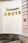 The entrance to Champagne Deutz the name in gold coloured letters on a white wall at Champagne Deutz in Ay, Vallee de la Marne, Champagne, Marne, Ardennes, France