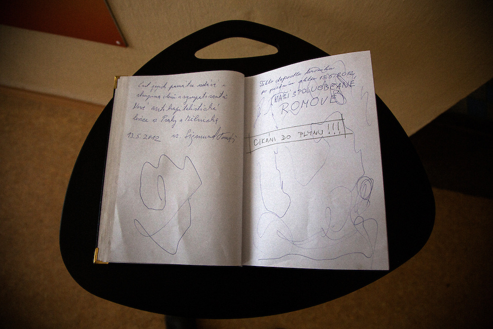 """A guest book signed with the words """"Gypsies to the Gas!"""" at the memorial center for the Roma internment camp at Lety, Czech Republic."""