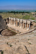 Picture of A Roman Theatre reconstructed over an earlier Greek theatre under the reign of Hadrian after the earthquake of 60 AD. The facade is 300 feet (91m) long, the full extent of which remains standingand the cavea has 50 rows of seats. Hierapolis archaeological site near Pamukkale in Turkey. .<br /> <br /> If you prefer to buy from our ALAMY PHOTO LIBRARY  Collection visit : https://www.alamy.com/portfolio/paul-williams-funkystock/pamukkale-hierapolis-turkey.html<br /> <br /> Visit our TURKEY PHOTO COLLECTIONS for more photos to download or buy as wall art prints https://funkystock.photoshelter.com/gallery-collection/3f-Pictures-of-Turkey-Turkey-Photos-Images-Fotos/C0000U.hJWkZxAbg