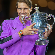 2019 US Open Tennis Tournament- Day Fourteen.   Rafael Nadal of Spain celebrates with the winners trophy after his five set victory against Danill Medvedev of Russia in the Men's Singles Final on Arthur Ashe Stadium during the 2019 US Open Tennis Tournament at the USTA Billie Jean King National Tennis Center on September 8th, 2019 in Flushing, Queens, New York City.  (Photo by Tim Clayton/Corbis via Getty Images)