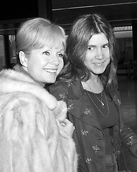 File photo dated 12/02/1972 of Carrie Fisher, 15 (right) and her mother Debbie Reynolds en route to Madrid at Heathrow Airport in London, as she has been rushed to hospital after suffering a stroke, barely a day after the death of her daughter Carrie Fisher, according to reports.
