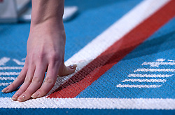 HAND ON THE TRACK BEFORE START IN WOMEN'S 400 METERS SEMIFINAL DURING EUROPEAN ATHLETICS INDOOR CHAMPIONSHIPS PARIS 2011 AT BERCY HALL...PARIS , FRANCE , MARCH 04, 2011..( PHOTO BY ADAM NURKIEWICZ / MEDIASPORT )..PICTURE ALSO AVAIBLE IN RAW OR TIFF FORMAT ON SPECIAL REQUEST.