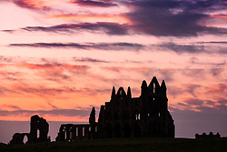 © Licensed to London News Pictures. 19/04/2018. Whitby UK. Picture shows the sunset at Whitby Abbey last night. Photo credit: Andrew McCaren/LNP