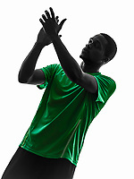 one african man soccer player applauding green jersey in silhouette on white background