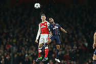Laurent Koscielny of Arsenal and Lucas of Paris Saint-Germain jump for a header. UEFA Champions league group A match, Arsenal v Paris Saint Germain at the Emirates Stadium in London on Wednesday 23rd November 2016.<br /> pic by John Patrick Fletcher, Andrew Orchard sports photography.