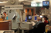 1990s staff of the BBC work at the broadcasters World Service station, 21st June 2018, in London, England. The BBC World Service occupied four wings of the building. Broadcasting from Bush House lasted for 70 years, from winter 1941 to summer 2012. Sections of Bush House were completed and opened over a period of 10 years: Centre Block was opened in 1925, North-West Wing in 1928, North-East Wing in 1929, South-East Wing in 1930, and South-West Wing in 1935. The full building complex was completed in 1935.