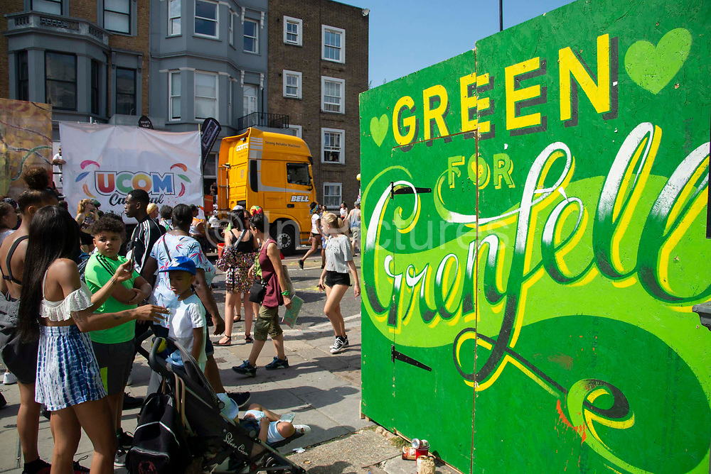 The Grenfell Tower fire tragedy is remembered at  Notting Hill carnival on 25th August, 2019 in London, United Kingdom. One million people are expected on the streets in scorching temperatures for the Notting Hill Carnival, Europes largest street party and a celebration of Caribbean traditions.