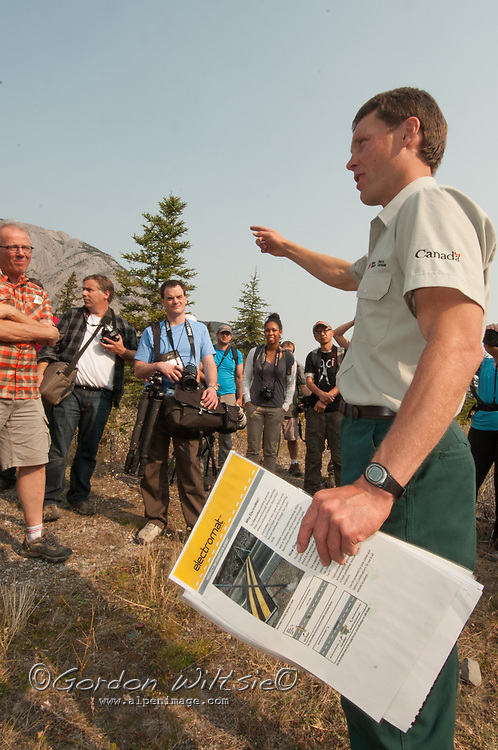 A park ranger describes the wildlife overpasses that enable animals to cross the Trans-Canada Highway in Banff National Park, Alberta, Canada.