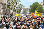 """London, United Kingdom, May 29, 2021: Thousands of people questioning pandemic outbreak, vaccines, the mainstream media and the politicians in Downing Street as well as around the world waving multinational flags and holding placards and banners march during a """"United for Freedom"""" demonstration in central London on Saturday, May 29, 2021. (Photo by Vudi Xhymshiti)"""