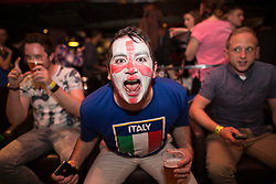 © Licensed to London News Pictures . 14/06/2014 .  Manchester , UK . A man with England facepaint and an Italy shirt . Football fans in Walkabout in Manchester City Centre this evening (Saturday 14th June 2014) as England play Italy in their first match of the 2014 World Cup , in Brazil . Photo credit : Joel Goodman/LNP
