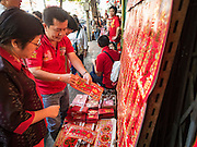 "08 FEBRUARY 2016 - BANGKOK, THAILAND:  A vendor sells Chinese New Year's gift and greeting cards in Bangkok's Chinatown district, during the celebration of the Lunar New Year. Chinese New Year is also called Lunar New Year or Tet (in Vietnamese communities). This year is the ""Year of the Monkey."" Thailand has the largest overseas Chinese population in the world; about 14 percent of Thais are of Chinese ancestry and some Chinese holidays, especially Chinese New Year, are widely celebrated in Thailand.      PHOTO BY JACK KURTZ"