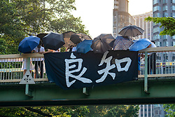 Wanchai, Hong Kong. 26 September, 2019. Human chain formed by students from local secondary schools in Hong Kong to support the pro democracy movement and anti-extradition bill. Banner meaning Conscience hung on bridge by school students