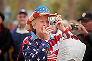 14 FEBRUARY 2012 - PHOENIX, AZ:  GERRI MCVICAR, from Payson, AZ, takes a picture during centennial festivities at the State Capitol in Phoenix, Feb 14. Arizona's statehood day is February 14 and this year Arizona marked 100 years of statehood. It was the last state in the 48 contiguous United States.    PHOTO BY JACK KURTZ
