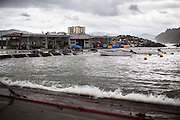 The earth quake causes a serious ground sinking. Sodehama fish port, used to be 15 families making a living in fish industry, was destroyed the fishing boats, equipments and fish processing factory. When it's high tide, some part of the fish port are totally flooded.