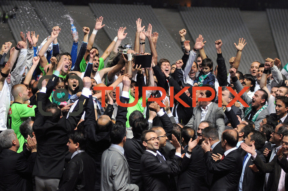 Konyaspor's players Omer HACISALIHOGLU (C) celebrate with the BankAsya Cup trophy during their Turkish soccer Play Off final match Altayspor between Konyaspor at Ataturk Olympic Stadium in Istanbul Turkey on Sunday, 23 May 2010. Photo by TURKPIX