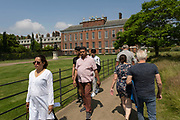 On the day after what would have been the 60th birthday of Princess Diana, people visit Kensington Palace in Hyde Park on 2nd July 2021 in London, United Kingdom. Diana, Kensington Palace was the former residence of Princess of Wales became known as the Peoples Princess following her tragic death.