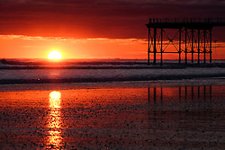 © Licensed to London News Pictures. <br /> 07/04/2017<br /> Saltburn-by-the-Sea, UK. <br />  <br /> The rising sun reflects off wet sand and sea at Saltburn-by-the-Sea in North Yorkshire. <br /> <br /> <br /> Photo credit: Ian Forsyth/LNP