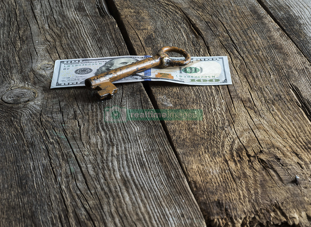 February 11, 2017 - vintage key on 100 dollars banknote on old wooden weavered background (Credit Image: © Igor Golovniov/ZUMA Wire)
