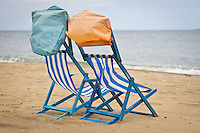 Empty deck-chairs await, holidays on the Isle of Wight