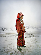 Shirin Bu looking for her brother to come back with teh sheep herd. .Campment of Ortobil (Sufi), all the way at the end of the Little Pamir, near the Tajik/China border. .Winter expedition through the Wakhan Corridor and into the Afghan Pamir mountains, to document the life of the Afghan Kyrgyz tribe. January/February 2008. Afghanistan