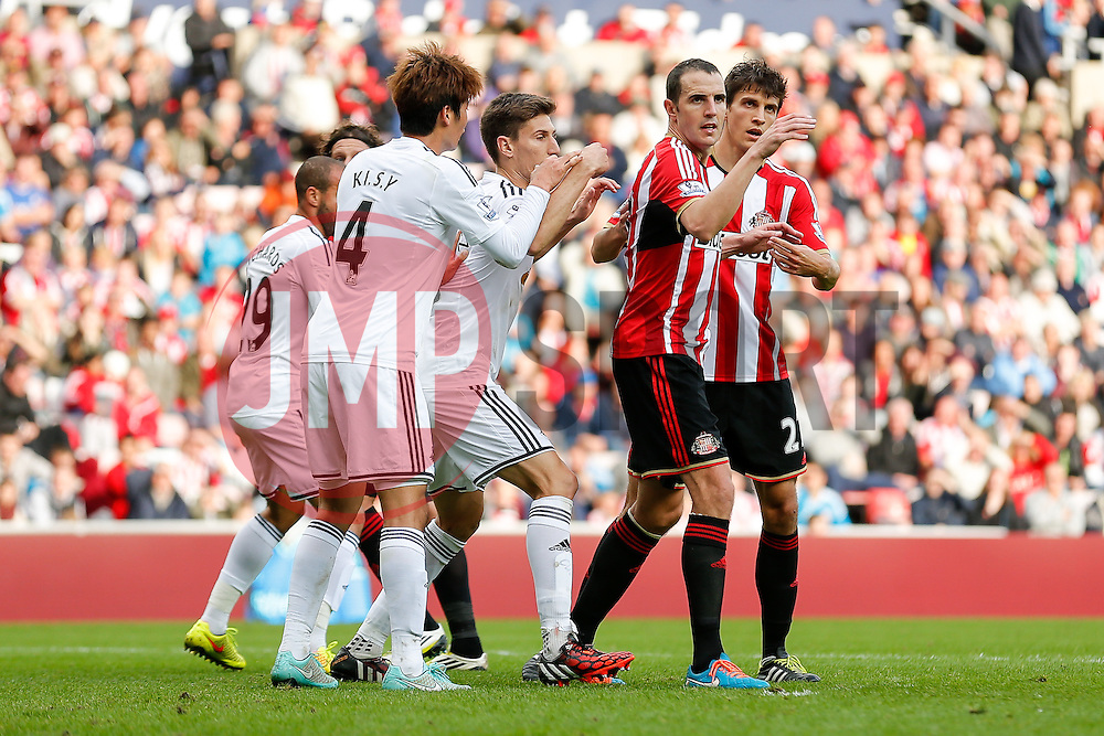 John O'Shea of Sunderland in action - Photo mandatory by-line: Rogan Thomson/JMP - 07966 386802 - 27/08/2014 - SPORT - FOOTBALL - Sunderland, England - Stadium of Light - Sunderland v Swansea City - Barclays Premier League.