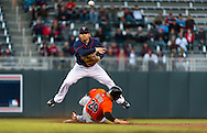 Brian Dozier #2 of the Minnesota Twins jumps over Greg Dobbs #29 of the Miami Marlins attempting to turn a double play in Game 2 of a split doubleheader on April 23, 2013 at Target Field in Minneapolis, Minnesota.  The Marlins defeated the Twins 8 to 5.  Photo: Ben Krause