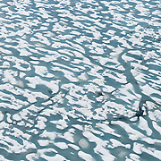 Cambridge Bay, viewed from a float plane, ice holding on into late July, Nunavut, Canada.