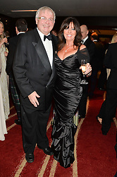 CHRISTOPHER BIGGINS and VICKI MICHELLE at the Soldiering On Awards held at the Park Plaza Hotel, Westminster Bridge, London on 5th April 2014.