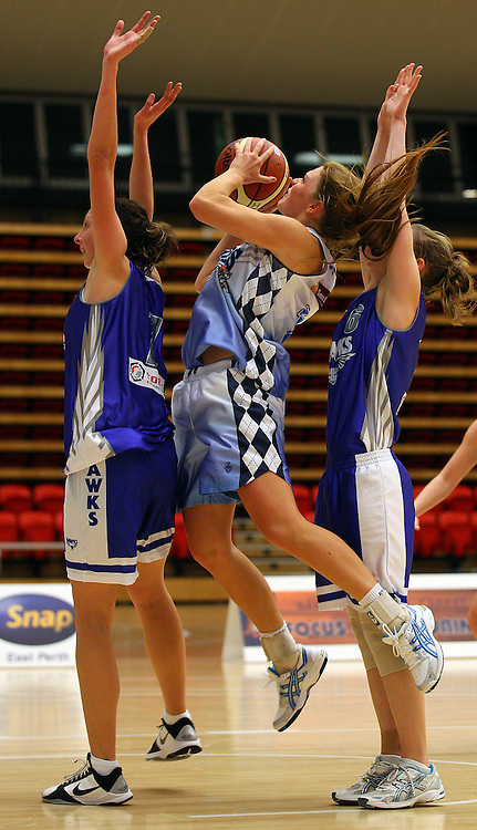 PERTH, AUSTRALIA - JULY 16: Jasmine Hooper of the Tigers lays up during the week 18 SBL game between the Perry Lakes Hawks and the Willetton TIgers at The State Basketball Center on July 16, 2011 in Perth, Australia.  (Photo by Paul Kane/All Sports Photography)