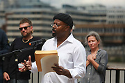 Art work by Ackroyd & Harvey made in grass with words by Ben Okri is set to float on the rising tide on the Thames on the 25th of June 2021, Central London, United Kingdom. Ben Okri speaking at the event with Damian Albarn, Dan Harvey and Kelly Hill in the back ground. <br />  The message is a call for action to save the planet from climate change catastrophe. The art work was moved by activists and laid onto a raft on the Thames as the tide was rising. The event marks the launch of XR Writers Rebel's Paint the Land project, which teams acclaimed writers and artists to create landscape graffitos drawing attention to the climate and ecological emergency. The Speakers at the event included the artist Ackroyd & Harvey, writer Ben Okri, Kelly Hill and Simon Bramwell, co-founder of Extinction Rebellion.  The event finished with a song by Damon Albarn and Mirabella Okra and the Capital Choir.